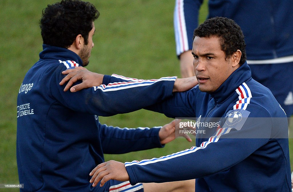 France's rugby union national team's captain Thierry Dusautoir (R) stretches during a training session, on February 7, 2013 in Marcoussis, south of Paris, as part of the preparation of the Six Nations tournament. France will play Wales in their Six Nations' match on February 9, 2013 in Saint-Denis.