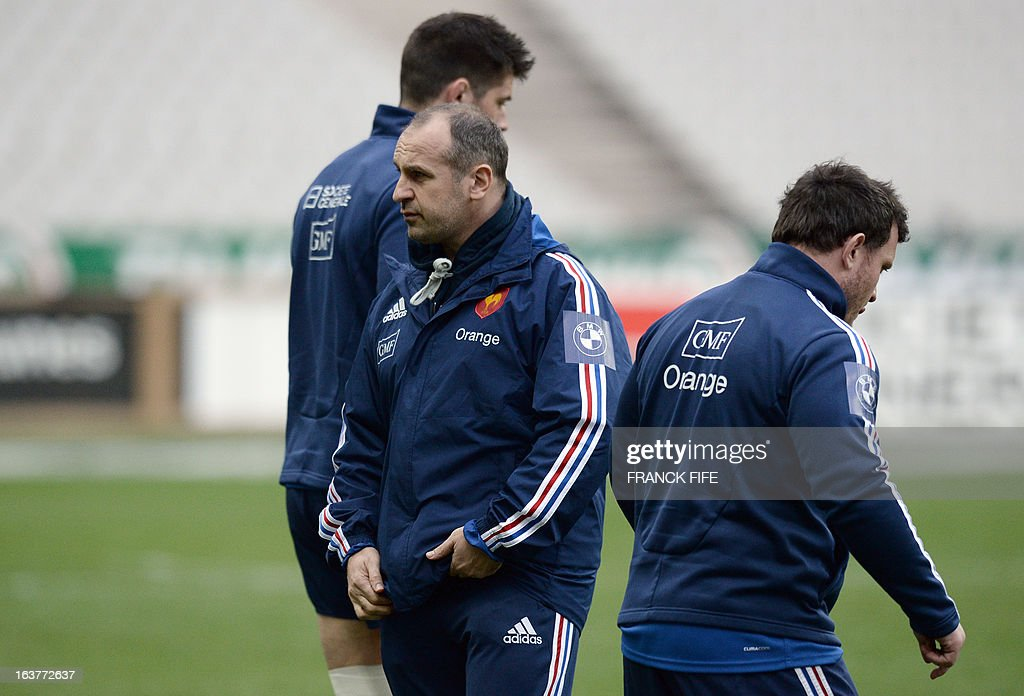 France's rugby union national team's coach Philippe Saint Andre (C) attends a training session, on March 15, 2013 at the Stade de France in Saint-Denis, north of Paris, on the eve of the rugby union 6 Nations tournament match against Scotland.