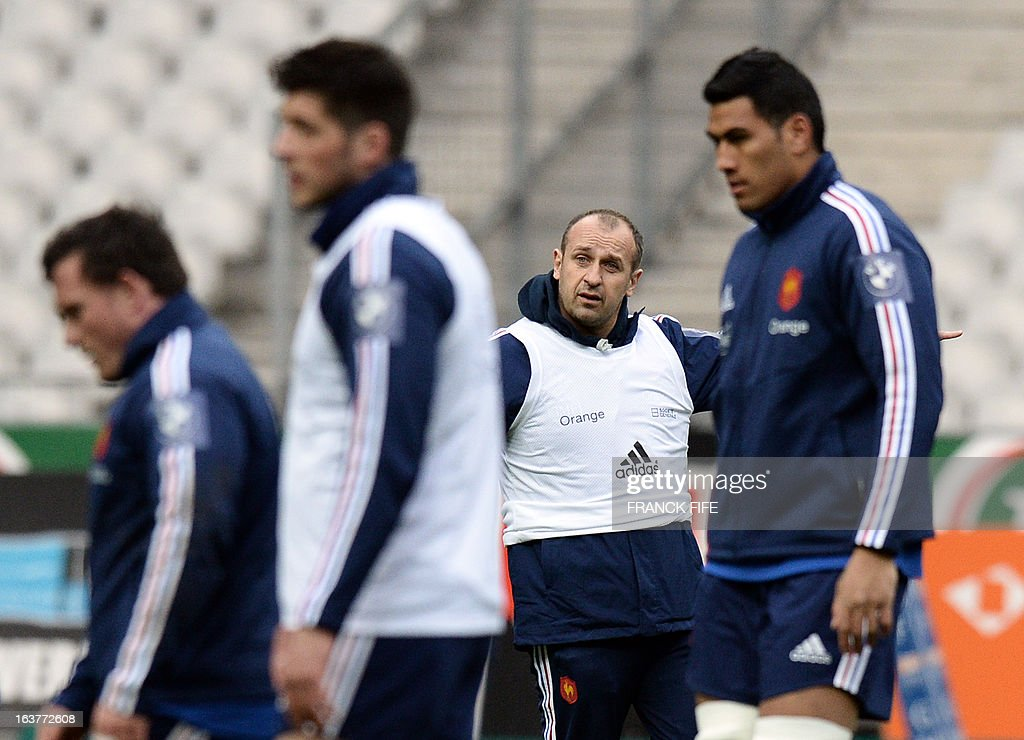 France's rugby union national team's coach Philippe Saint Andre (C) heads his team's training session, on March 15, 2013 at the Stade de France in Saint-Denis, north of Paris, on the eve of the rugby union 6 Nations tournament match against Scotland.