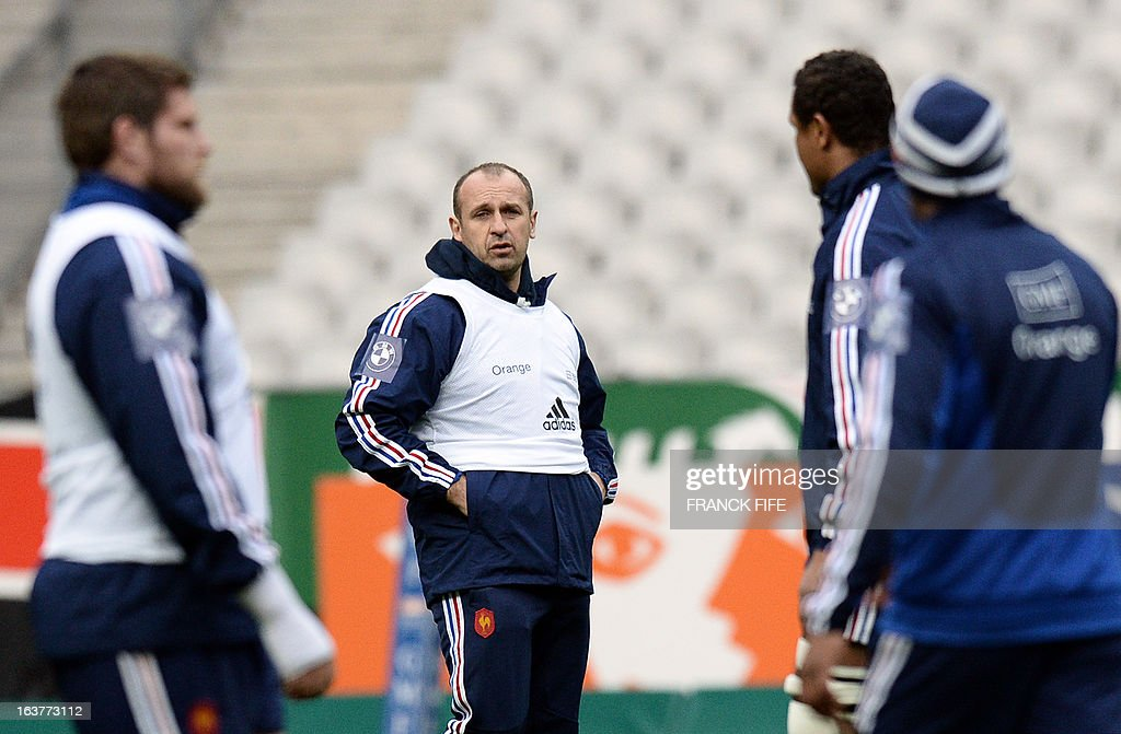 France's rugby union national team's coach Philippe Saint Andre (C) heads his team's training session, on March 15, 2013 at the Stade de France in Saint-Denis, north of Paris, on the eve of the rugby union 6 Nations tournament match against Scotland. AFP PHOTO / FRANCK FIFE
