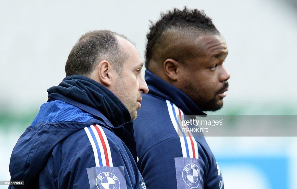France's rugby union national team's coach Philippe Saint Andre (L) speaks with centre Mathieu Bastereaud during a training session, on March 15, 2013 at the Stade de France in Saint-Denis, north of Paris, on the eve of the rugby union 6 Nations tournament match against Scotland.