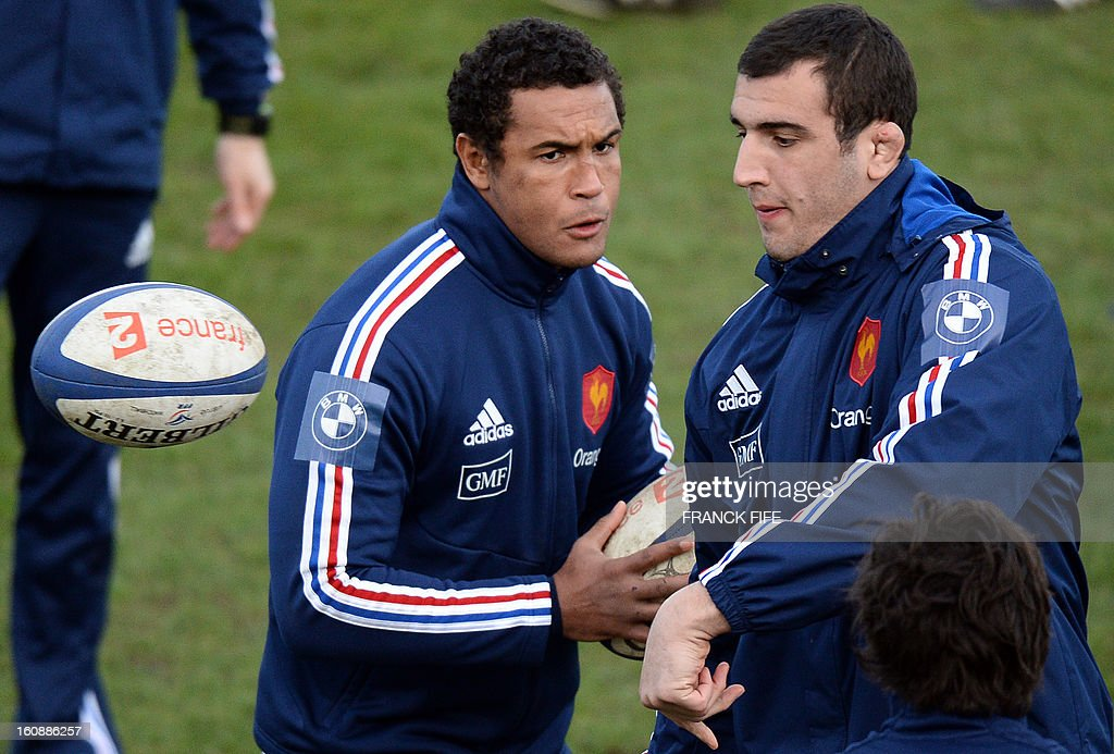 France's rugby union national team's lock Yoann Maestri (R) passes the ball next to captain Thierry Dusautoir during a training session, on February 7, 2013 in Marcoussis, south of Paris, as part of the preparation of the Six Nations rugby union tournament. France will play Wales in their Six Nations' rmatch on February 9, 2013 in Saint-Denis.