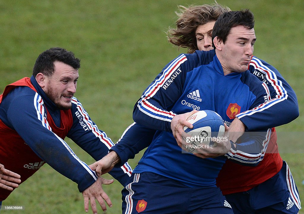 France's rugby union national team's N°8 Louis Picamoles vies with hooker Dimitri Szarzewski (R) and loose head prop Thomas Domingo (L) during a training session, on November 22, 2012 in Marcoussis, south of Paris, as part of the preparation for the upcoming last test match against Samoa. AFP PHOTO / FRANCK FIFE