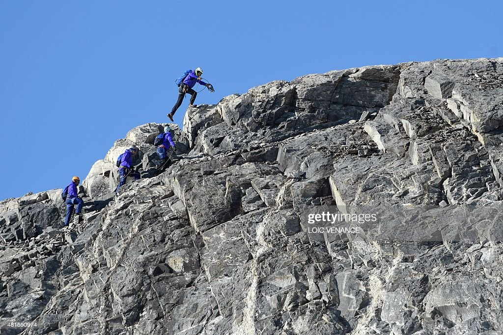 France's rugby union team players climb the Grande Motte glacier during their training camp in Tignes southeastern France on July 22 2015 ahead of...