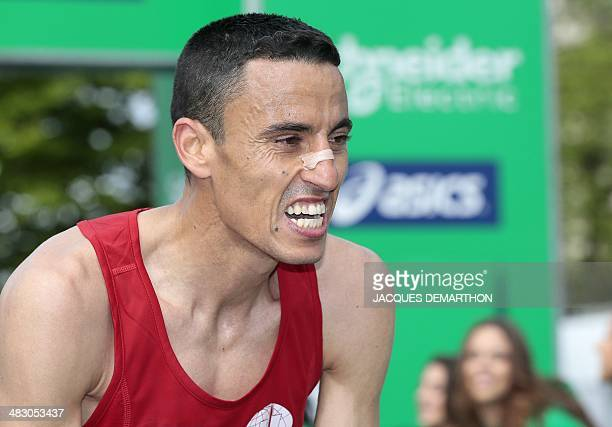 France's runner Ahmed Ezzobayry reacts after finishing in the eleventh position and the first French man of the 38th Paris Marathon on April 6 in...