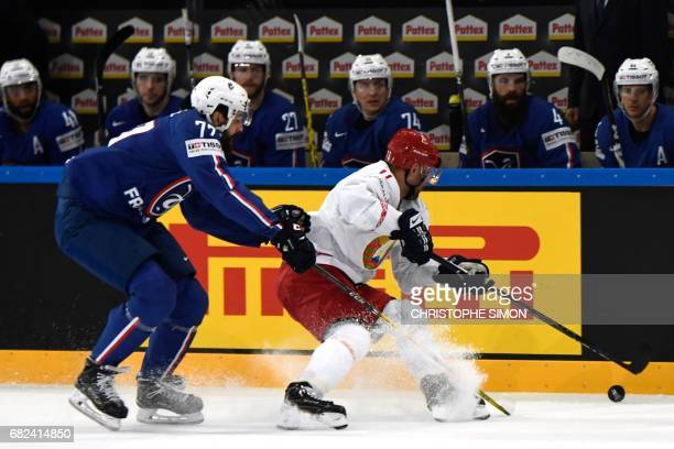 France's Sacha Treille vies with Belarus' Alexander Kulakov during the IIHF Men's world Championship group B ice hockey match between France and...