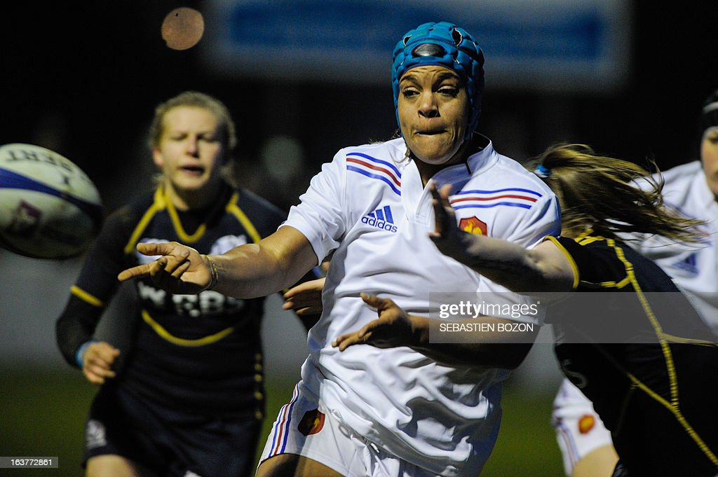France's Safi N'Diaye (C) passes the ball during the Six Nations women's international rugby union match between France and Scotland at the Bourillot Stadium in Longvic, eastern France, on March 15, 2013.