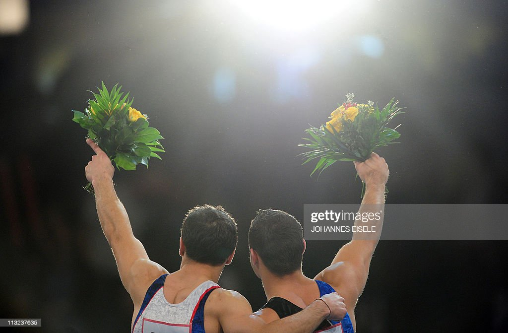 France's Samir Ait Said and France's Thomas Bouhail celebrate on the podium during the victory ceremony of the men's apparatus finals on the vault...