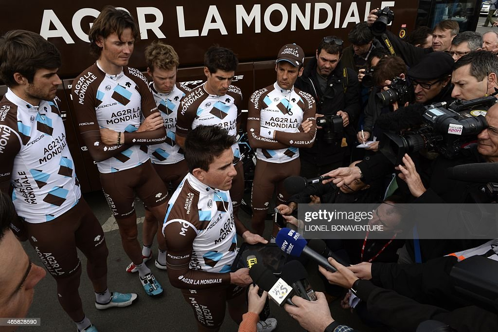 France's <a gi-track='captionPersonalityLinkClicked' href=/galleries/search?phrase=Samuel+Dumoulin&family=editorial&specificpeople=760365 ng-click='$event.stopPropagation()'>Samuel Dumoulin</a> (C-bottom) reads a statement to journalists, flanked by teammates of the France's AG2R La Mondiale cycling team, (From L) Luxembourg's Ben Gastauer, Belgium's <a gi-track='captionPersonalityLinkClicked' href=/galleries/search?phrase=Johan+Van+Summeren&family=editorial&specificpeople=750486 ng-click='$event.stopPropagation()'>Johan Van Summeren</a>, Belgium's <a gi-track='captionPersonalityLinkClicked' href=/galleries/search?phrase=Jan+Bakelants&family=editorial&specificpeople=7818461 ng-click='$event.stopPropagation()'>Jan Bakelants</a>, France's <a gi-track='captionPersonalityLinkClicked' href=/galleries/search?phrase=Sebastien+Minard&family=editorial&specificpeople=858381 ng-click='$event.stopPropagation()'>Sebastien Minard</a> and France's <a gi-track='captionPersonalityLinkClicked' href=/galleries/search?phrase=Jean-Christophe+Peraud&family=editorial&specificpeople=777897 ng-click='$event.stopPropagation()'>Jean-Christophe Peraud</a>, following the doping scandal concerning French rider <a gi-track='captionPersonalityLinkClicked' href=/galleries/search?phrase=Lloyd+Mondory&family=editorial&specificpeople=858378 ng-click='$event.stopPropagation()'>Lloyd Mondory</a> of the AG2R La Mondiale team, before the start of the third stage of the 73rd edition of the Paris-Nice cycling race, between Saint-Amand-Montrond and Saint-Pourcain-sur-Sioule, on March 11, 2015. Mondory, 32, who has twice taken part in the Tour de France, returned a positive test for the performance-enhancing blood booster on February 17, 2015. The team face suspension over the charges and are in danger of having their participation in this year's Tour de France participation called into question. AFP PHOTO / LIONEL BONAVENTURE