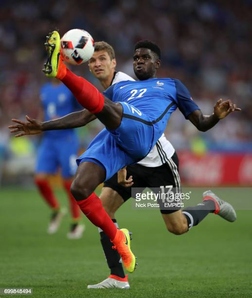France's Samuel Umtiti and Germany's Thomas Muller battle for the ball
