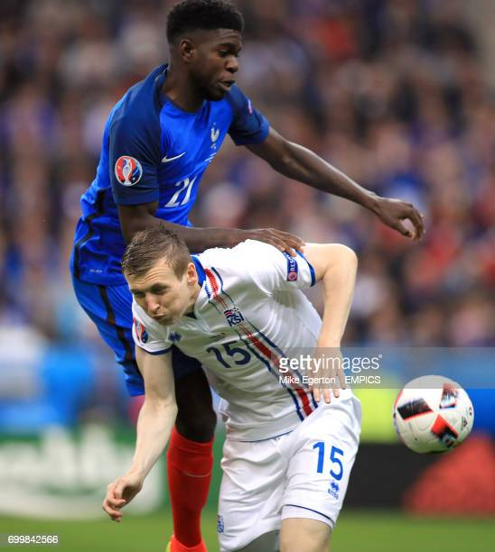 France's Samuel Umtiti and Iceland's Jon Dadi Bodvarsson battle for the ball