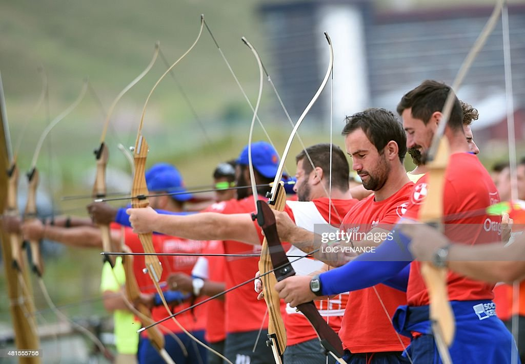 France's scrum half Morgan Parra attends an archery session during an archery session as part of the French rugby union team's training camp in...