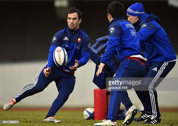 France's scrum half Morgan Parra passes the ball during a training session in Marcoussis south of Paris on February 24 as part of the preparation for...