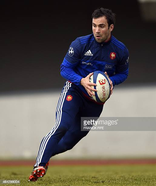 France's scrum half Morgan Parra runs with the ball during a training session in Marcoussis south of Paris on February 24 as part of the preparation...
