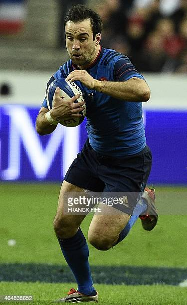 France's scrum half Morgan Parra runs with the ball during the Six Nations international rugby union match between France and Wales on February 28...