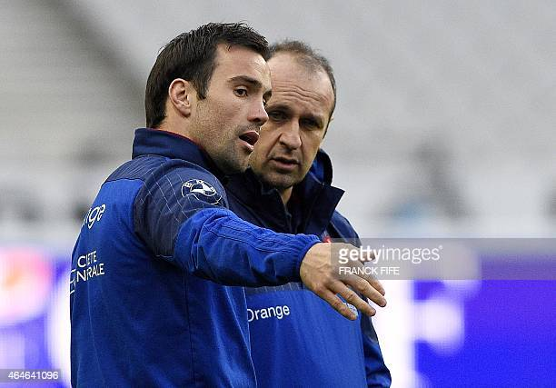 France's scrum half Morgan Parra speaks with France's head coach Philippe Saint Andre during a training session on February 27 2015 at the Stade de...