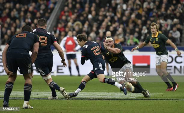 France's scrumhalf Baptiste Serin is tackled during the friendly rugby union international Test match between France and South Africa's Springboks at...