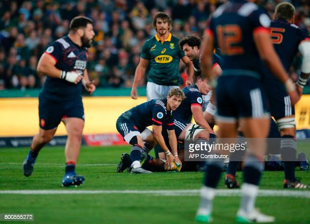 France's scrumhalf Baptiste Serin prepares to pass the ball during the third rugby union Test match between South Africa and France at The Emirates...