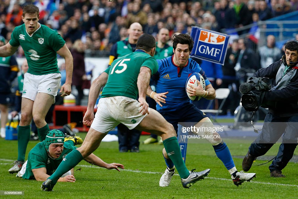 France's scrumhalf Maxime Machenaud faces Ireland's wing Rob Kearney during the Six Nations international rugby union match between France and...