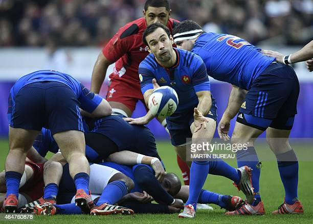 France's scrumhalf Morgan Parra passes the ball during the Six Nations international rugby union match between France and Wales on February 28 2015...