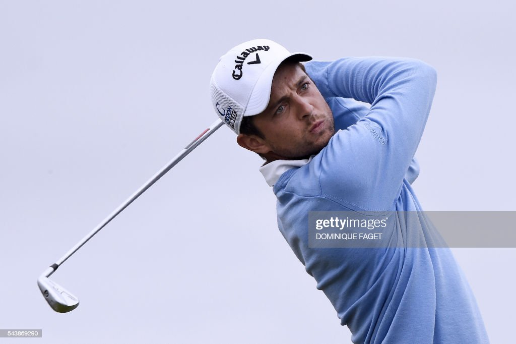 France's Sebastien Gros plays off the 9th tee during the first round of the 100th French Golf Open on July 30, 2016 at Le Golf National in Guyancourt, near Paris. / AFP / DOMINIQUE