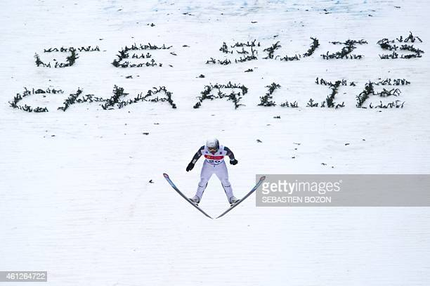 France's Sebastien Lacroix soars through the air over a message that reads 'Je suis Charlie' in reference to an attack by gunmen in which 12 people...