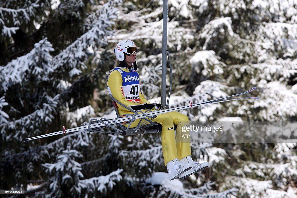 France's Sebastien Lacroix uses a chair lift on February 22, 2013 during the Men's Nordic Combined Normal Hill Individual Gundersen of the FIS Nordic World Ski Championships at the Ski Jumping stadium in Predazzo, northern Italy.