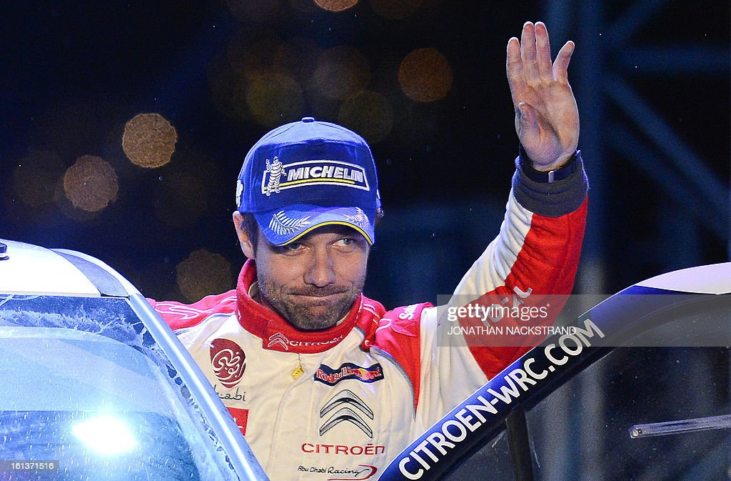 France's Sebastien Loeb 2nd placed of the FIA World Rally Championship second round waves during the winners ceremony in Karlstad, Sweden on February 10, 2013.