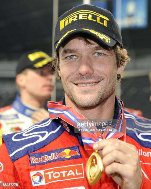 France's Sebastien Loeb shows off his medal after the awards ceremony for the Rally of Japan at the Sapporo Dome in Sapporo on November 2 2008 Loeb...