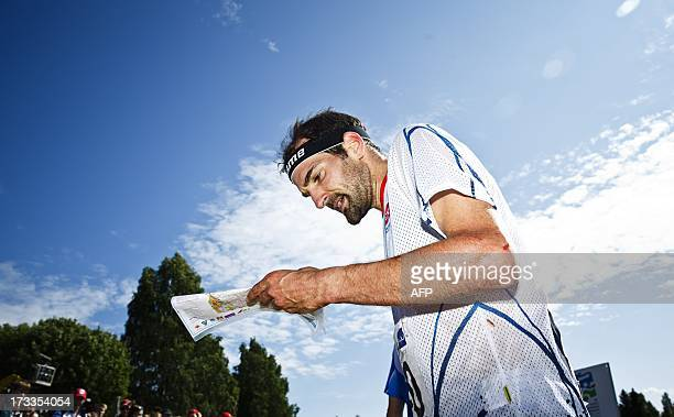 France's second placed Thierry Gueorgiou competes during the men's middle distance final in the IOF World Orienteering Championships 2013 in Sotkamo...