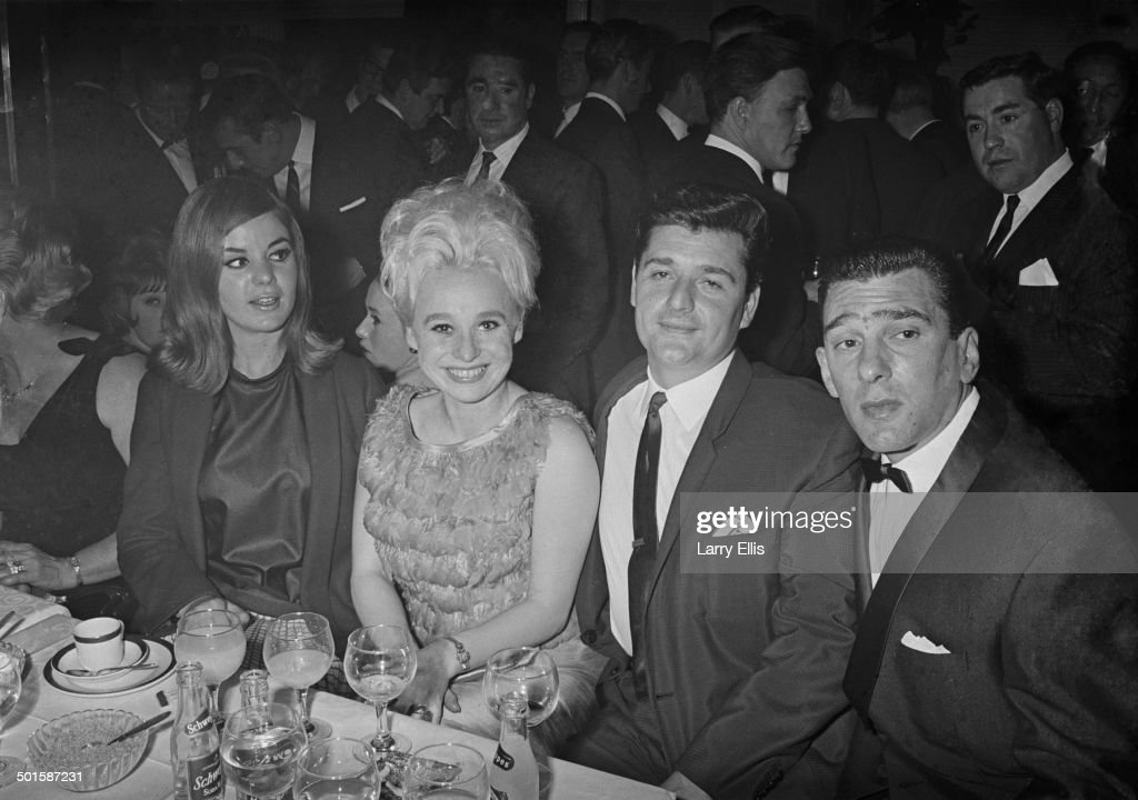 Frances Shea (1943 - 1967, far left) and her husband, English gangster <a gi-track='captionPersonalityLinkClicked' href=/galleries/search?phrase=Reggie+Kray&family=editorial&specificpeople=240485 ng-click='$event.stopPropagation()'>Reggie Kray</a> (1933 - 2000, far right) with actress <a gi-track='captionPersonalityLinkClicked' href=/galleries/search?phrase=Barbara+Windsor&family=editorial&specificpeople=210539 ng-click='$event.stopPropagation()'>Barbara Windsor</a> and her husband Ronnie Knight, an associate of the Krays, at the El Morocco nightclub, owned by the Kray Twins in Soho, London, 30th April 1965.