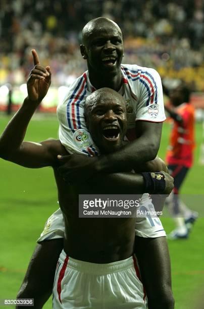 France's Sidney Govou and Lilian Thuram celebrate victory over Brazil
