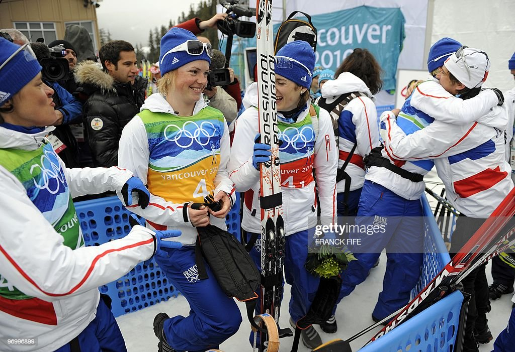 France's silver medalist Sylvie Becaert, Marie Dorin, Marie Laure Brunet and Sandrine Bailly celebrates after the Women's Biathlon 4x6km relay at Whistler Olympic Park on February 23, 2010 during the Vancouver Winter Olympics.
