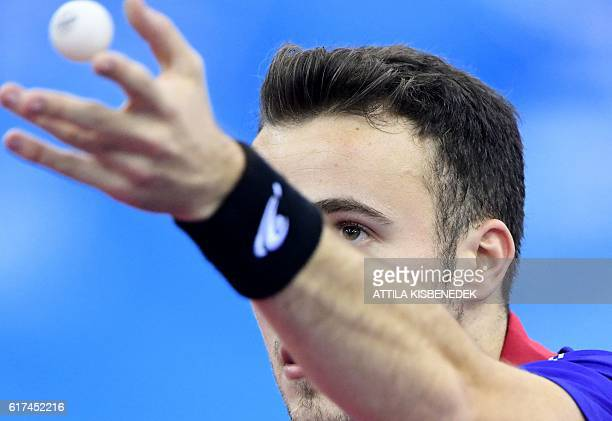 France's Simon Gauzy serves against France's Emmanuel Lebesson in 'Tuskecsarnok' sports hall of Budapest on October 23 2016 during the men final of...