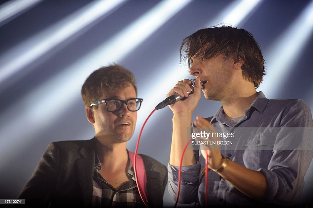 France's singer Thomas Mars (R) and guitarist Laurent Brancowitz from the band Phoenix perform on stage on July 6, 2013 on the third day of the Eurockeennes music festival, in the French eastern city of Belfort.