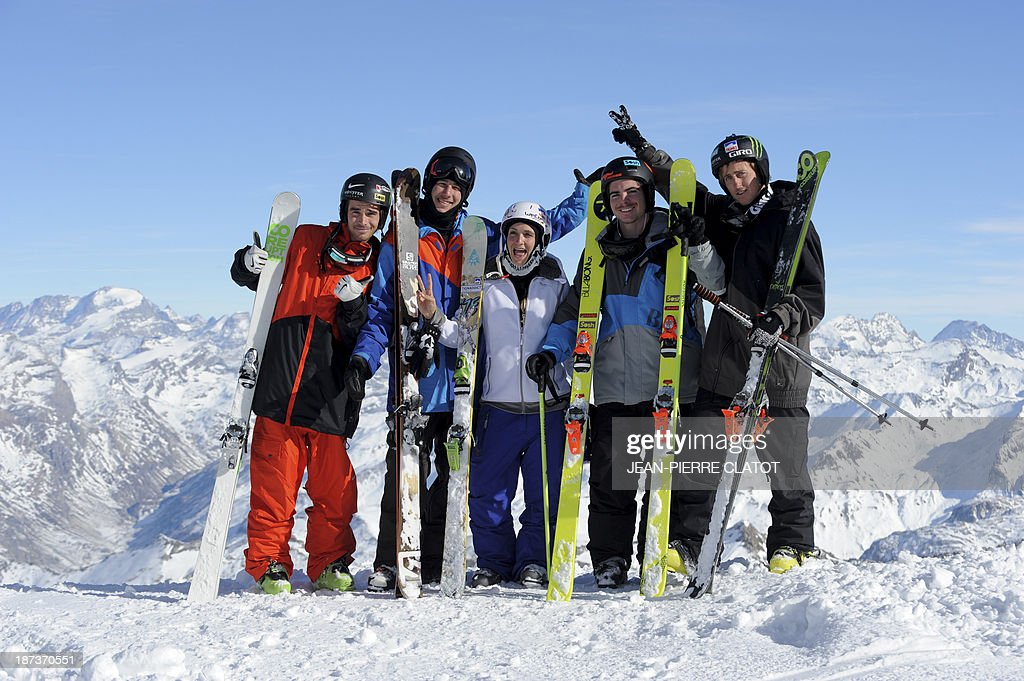 France's skiers Kevin Rolland, Thomas Krief, Marie Martinod, Ben Valentin and Xavier Bertoni pose for a picture during a practice session in Tignes on November 8, 2013 ahead of the 2014 Winter Olympics in Sochi.