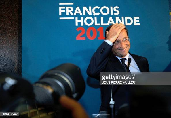 France's Socialist Party candidate for the 2012 French presidential election Francois Hollande gestures before speaking during a visit of a Serma...