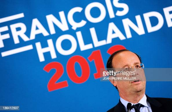 France's Socialist Party candidate for the 2012 French presidential election Francois Hollande speaks during a press conference after visiting a...