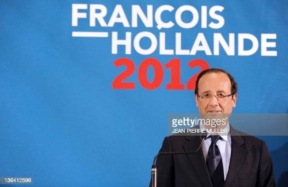 France's Socialist Party candidate for the 2012 French presidential election Francois Hollande is pictured during a press conference after visiting a...
