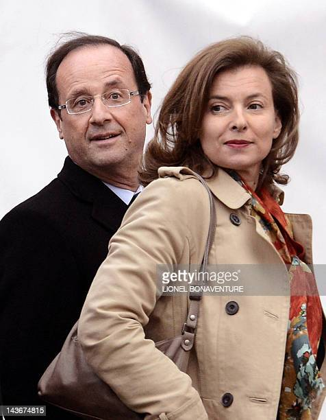 France's Socialist Party candidate for the 2012 French presidential election Francois Hollande and his partner Valerie Trierweiler arrive at the TV...