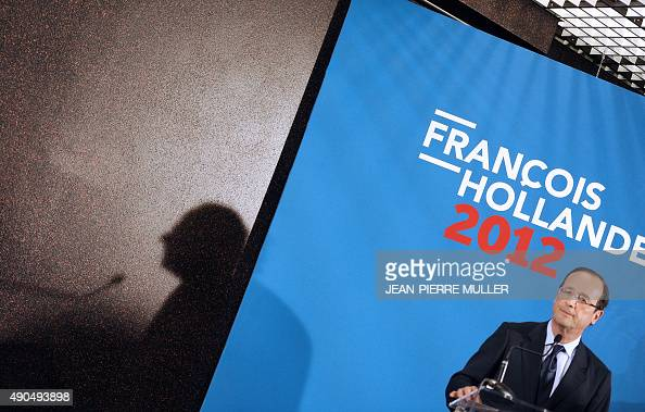 France's Socialist Party candidate for the 2012 French presidential election Francois Hollande speaks after visiting a plant of the Serma electronics...