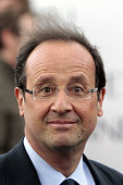 France's Socialist Party candidate for the 2012 French presidential election Francois Hollande leaves after meeting employees of the oil refinery of...