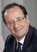 France's Socialist Party candidate for the 2012 French presidential election Francois Hollande listens to teachers and students families during a...