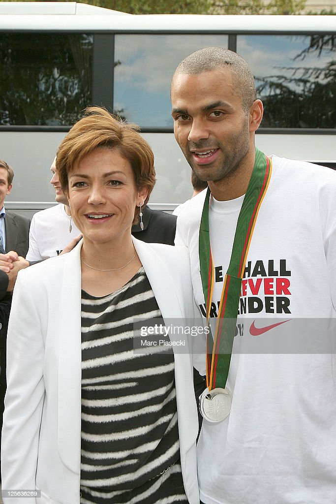 France's Sports Minister <a gi-track='captionPersonalityLinkClicked' href=/galleries/search?phrase=Chantal+Jouanno&family=editorial&specificpeople=5673060 ng-click='$event.stopPropagation()'>Chantal Jouanno</a> poses with France's basket national team player Tony Parker next to British Prime Minister Winston Churchill's statue on September 19, 2011 in Paris, France. One day after France's lost to Spain the Euro 2011 basketball Championships.