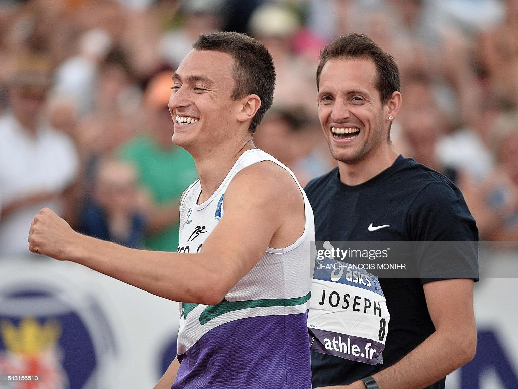 France's Stanley Joseph (L) is congratulated by France's Renaud Lavillenie (R) after competing during Men's Pole Vault Final at the French Athletics Elite championships on June 26, 2016 at the Lac de Maine stadium in Angers, western France. / AFP / JEAN