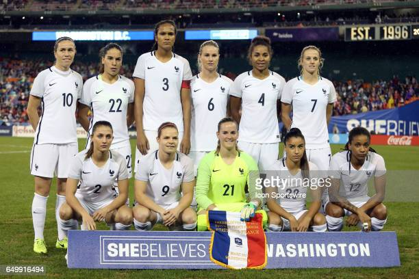 France's starters pose for a photo before the game Front row Eve Perisset Eugenie Le Sommer Meline Gerard Sakina Karchaoui Elodie Thomis Back row...