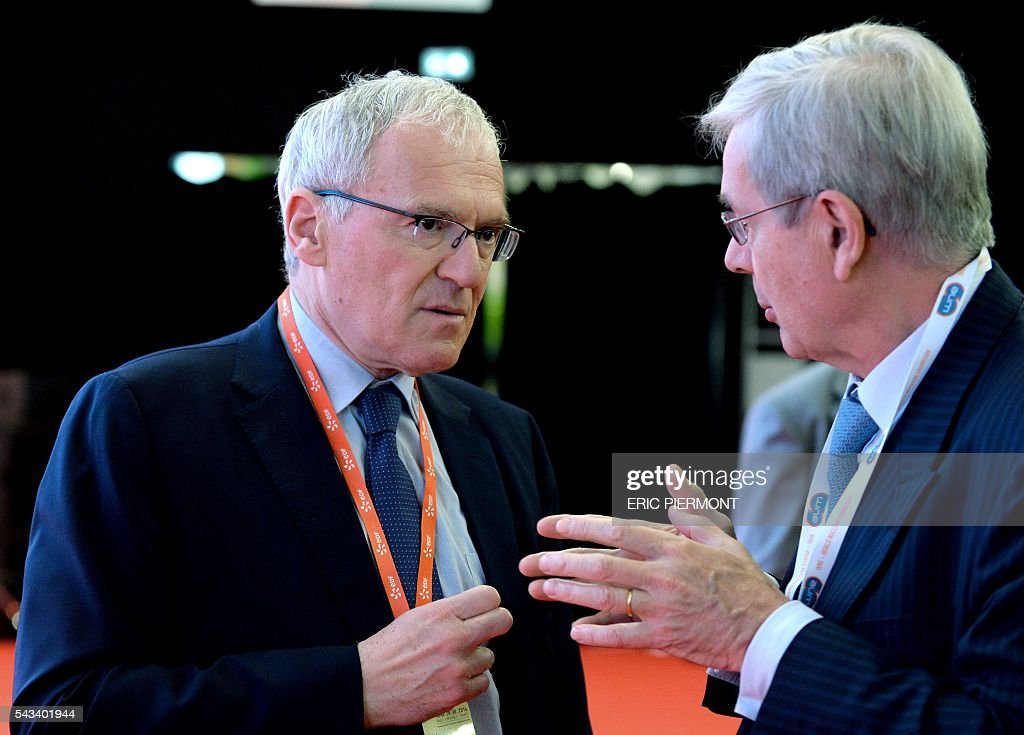 France's state-run power firm EDF Chief Executive Jean-Bernard Levy (L) speaks with Areva Chairman of the Board of Directors Philippe Varin (R) prior to the opening session of the World Nuclear Exhibition in Le Bourget, near Paris on June 28, 2016. / AFP / ERIC