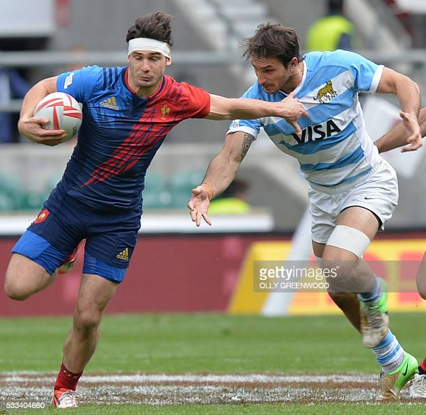 France's Steeve Barry makes a break during the plate semi final of the World Rugby Sevens Series London rugby union tournament between France and...