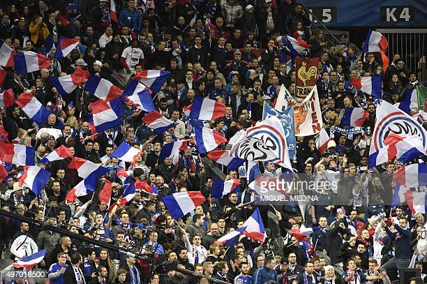 France's supporters cheer during a friendly international football match between France and Germany ahead of the Euro 2016 on November 13 2015 at the...