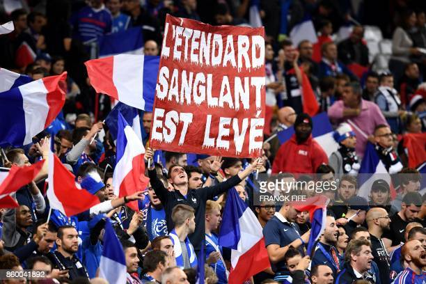 France's supporters cheer during the FIFA World Cup 2018 qualification football match between France and Belarus at the Stade de France in SaintDenis...